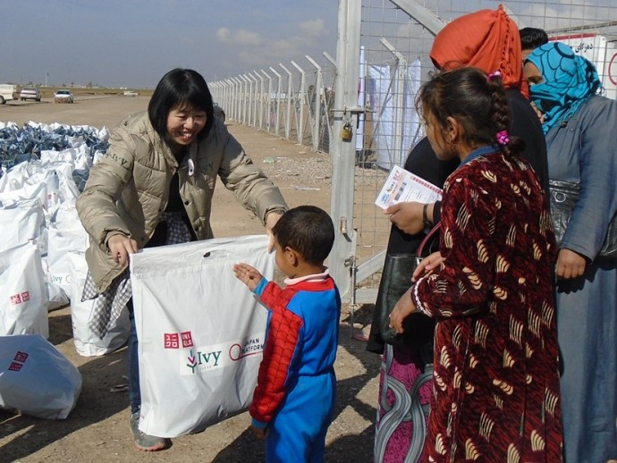 Japanese Project Manager distributing Winter Jackets
